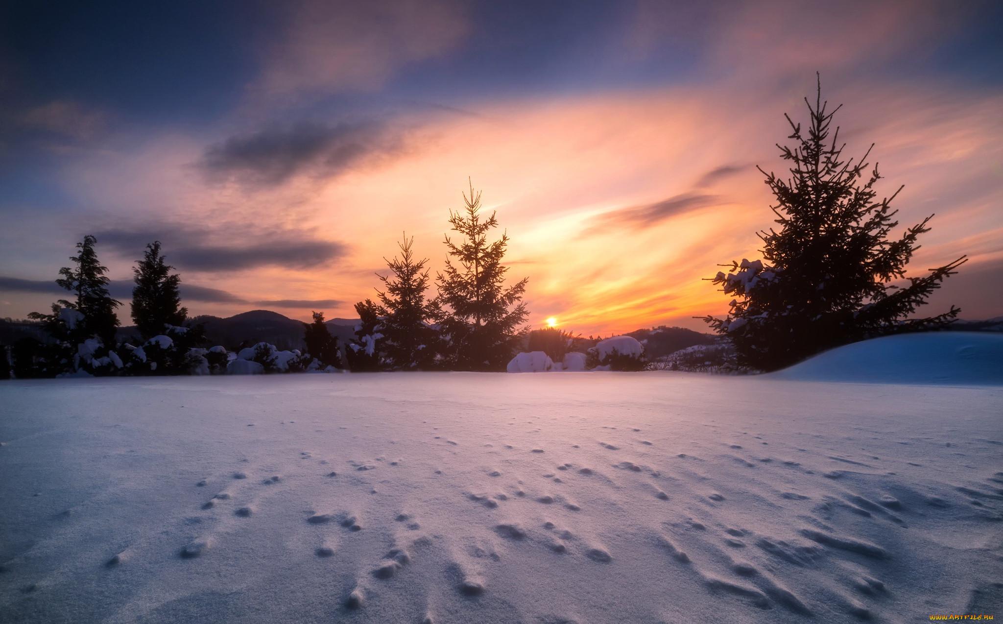 красивые фото падающего снега на закате